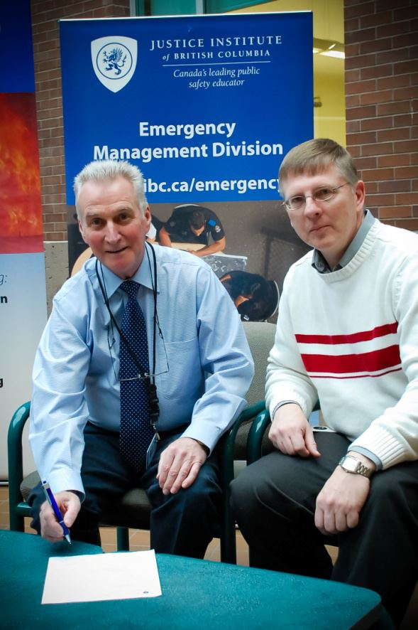 Don Bindon President of BCSARA and Jeff Cornell Program Manager Emergency Management Division signing agreement